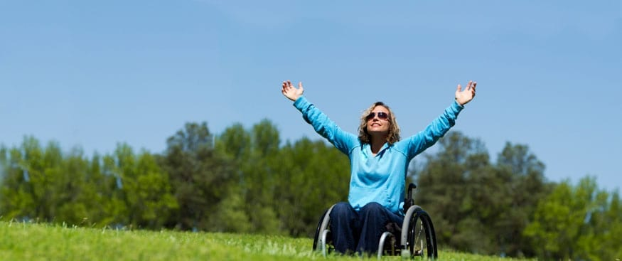 Happy wheelchair user in field
