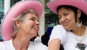 guest and volunteer in cowboy hats