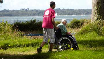 carer pushing guest in wheelchair