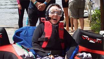 Revitalise guest on accessible water-skiing excursion