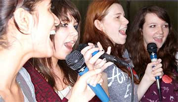 Revitalise volunteers singing