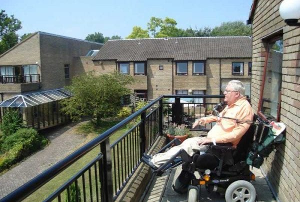 disabled guest in wheelchair on balcony at Netley Waterside House