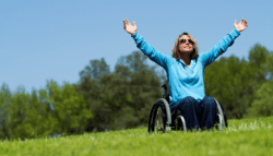 happy female in wheelchair
