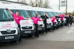 Drivers in front of Revitalise minibuses