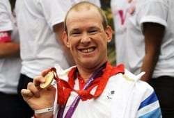 Paralympian Dan Bentley showing London 2012 medal