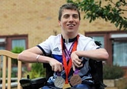 David Smith with Paralympic medals outside Jubilee Lodge