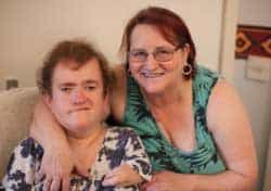 disabled guest and carer