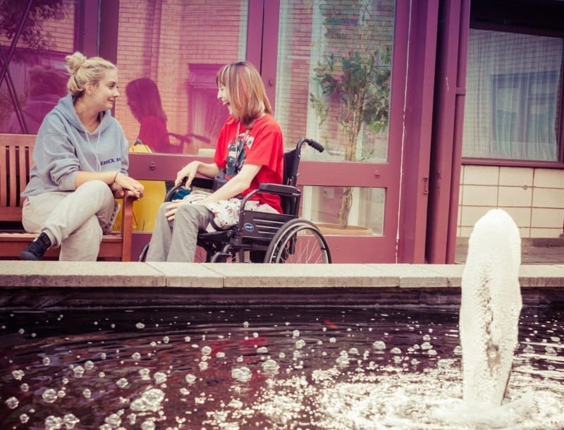 disabled guest in wheelchair and carer at Jubilee Lodge during Youth Week