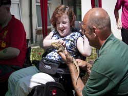 Revitalise guest with lizard as part of holiday experience