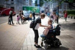 Guest and carer on accessible excursion