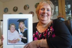 Lesley Mathews holding a picture of her daughter