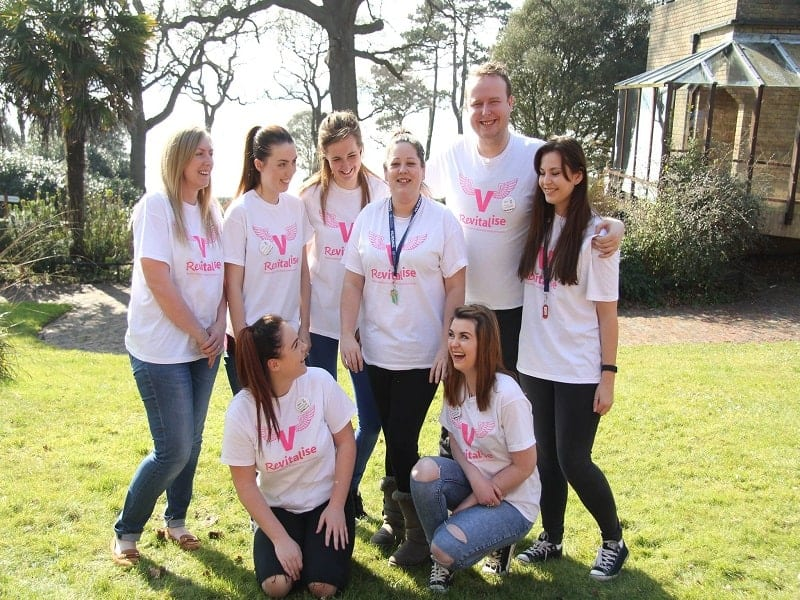 Group picture of Revitalise volunteers smiling