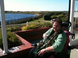 Shirley enjoying a cup of coffee on Sandpiper's sun terrace.