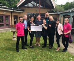 Former West Ham footballer Kenny Brown visited Revitalise Jubilee Lodge to present cheque