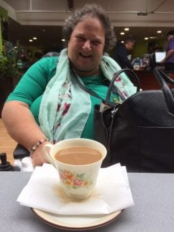 Shirley enjoying a cup of tea while out on excursion to Dobbies Garden Centres at Revitalise Sandpipers