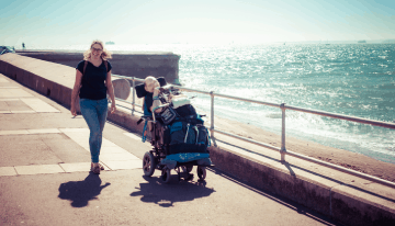 Guest and carer at the seaside