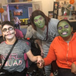 Volunteer with guests at Halloween Club Revitalise