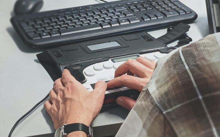 Person using braille writer