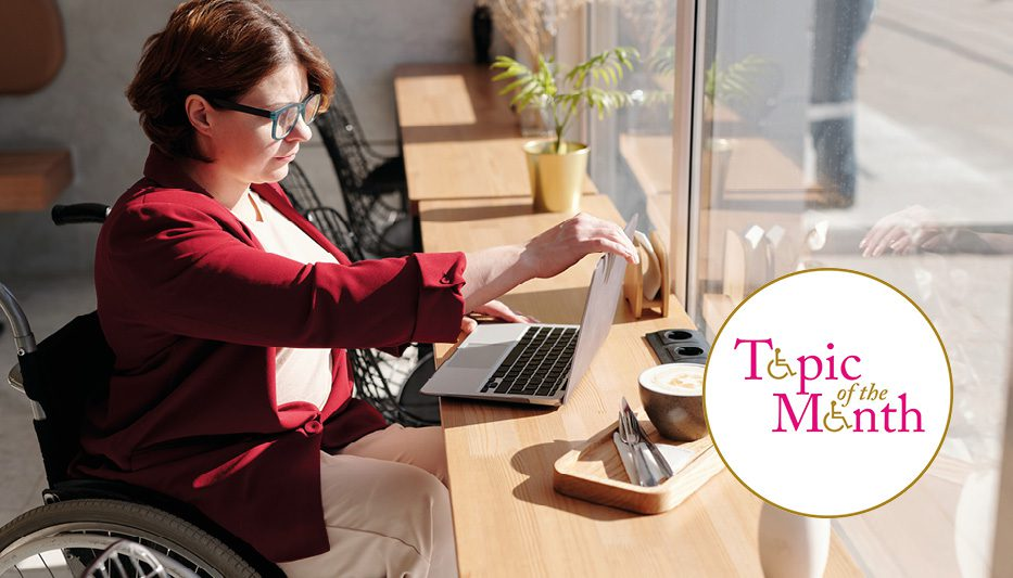 Woman in wheelchair using laptop with topic of the month logo overlay
